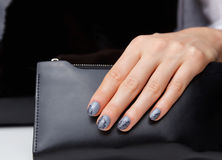 Close-up of grey nails with lace motives Royalty Free Stock Photos