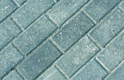 Close-up of grey pavement cobble stones. Stock Image