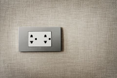 Close up grey plug on texture background. Royalty Free Stock Images