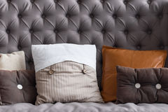 Close up of grey vintage couch with pillows Stock Images