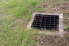 Close up Grille drain of sewer around the street or walkway . stock photography