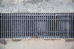 Close up Grille drain of sewer around the swimming pool. royalty free stock images