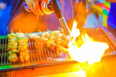 Close up of grilled in a barbecue on fire. Barbecue grill with v stock image