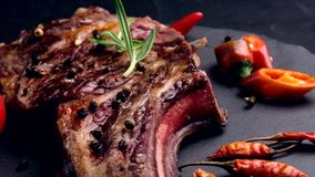 Grilled beef steak on bone with tomatoes stock footage