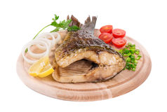 Close up of grilled carp steak. Royalty Free Stock Photos