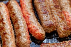 Close up grilled homemade meat sausages. Shallow depth a field. stock image