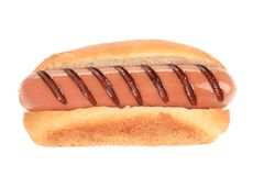 Close up of grilled hot dog. Isolated on a white background Royalty Free Stock Photos