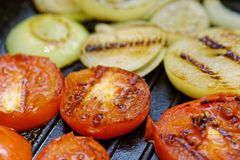 Close up grilled onion and tomatoes. Macro of a vegetable. Shallow depth a field. stock photography