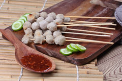 Close up,Grilled pork meatball skewers served. Selective focus. Stock Image