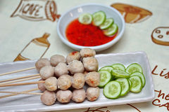Close up,Grilled pork meatball skewers served. Selective focus. Royalty Free Stock Photography