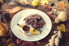 Close up of grilled pork ribs with lemon, sauce. And rosmary. Selective Focus Royalty Free Stock Images