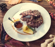 Close up of grilled pork ribs with lemon, sauce. And rosmary. Selective Focus Royalty Free Stock Image