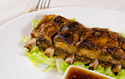 Close Up of Grilled Pork Ribs on Plate. Close Up of Grilled Pork Ribs Served on Plate as seen from Above Stock Photo
