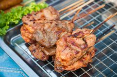 Close up Grilled Pork stick on grid  market, Thai cuisine traditional signature street food, quick delicious and easy eating. Close up Grilled Pork stick on grid Royalty Free Stock Image