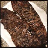 Skirt steaks on plate Stock Photo