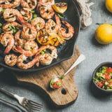 Close-up of grilled tiger prawns with lemon, leek, chili, sauce Royalty Free Stock Image