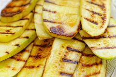 Close up grilled zucchini on plate. Macro of a vegetable. Shallow depth a field. royalty free stock photos