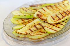 Close up grilled zucchini on plate. Macro of a vegetable. Shallow depth a field. stock photo