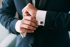 Free Close-up Groom Hands Puts On Cufflinks. Elegant Gentleman Clothers, White Shirt Royalty Free Stock Image - 151027166