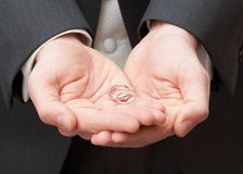 Close Up Of Groom Holding Wedding Rings Royalty Free Stock Image