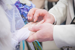 Close up Groom Put the Wedding Ring on bride. Happy Stock Photography
