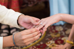 Close up ,The groom wearing wedding ring for his bride Stock Images