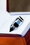Close-up grooms ring Stock Images