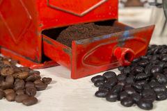 Close-up of ground coffee into a traditional manual coffee grinder Stock Image