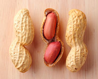 Close up of groundnuts. On wood background Stock Photos