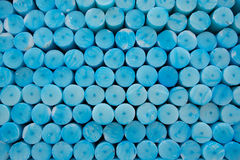 Close up of a group of blue circle candles in Lourdes in France. Stock Photos