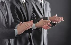 Close up.a group of business people applauding standin. G. success concept stock image