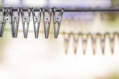 Close up group of clothespin on clothes line. Royalty Free Stock Images