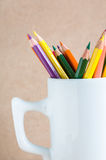 Close-up A group of color pencils in a white cup Stock Images