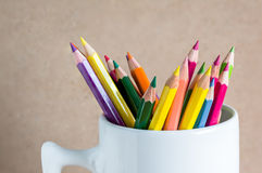 Close-up A group of color pencils in a white cup Stock Image
