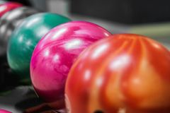 group of colored bowling balls in the club stock image
