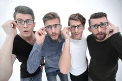 Close up. a group of creative friends looking at you through glasses. Stylized photo stock image