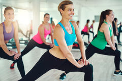 Close-up of group of fit young women stretching Royalty Free Stock Photo