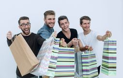 Close up.a group of friends with shopping bags pointing at you. The concept of choice Stock Photo