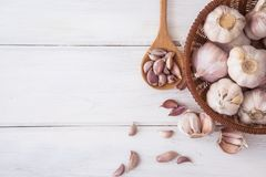 Close up a group of garlic on white wooden table board , top vie Royalty Free Stock Images