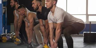 Close-up - Group of Male Muscular Friends Working Out in Gym. royalty free stock photography