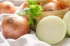 Close up group of onions on wooden table Royalty Free Stock Photos