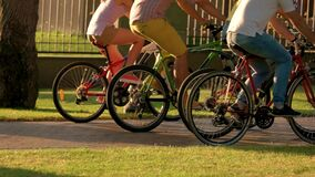 Close up group of people riding bicycles. stock footage