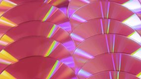 CD DVD disc colorful compact background rainbow shine plastic pink violet stock images