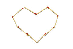 Close up of group of red match stick arrange in heart pattern isolated on a white background Stock Images