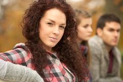 Close Up Of Group Of Teenage Friends. In Autumn Park Stock Image
