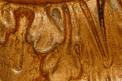 Close up of grunge golden potal texture. Foil on architectural detail. Cracelures and bitumen varnish. Selective macro focus Stock Images