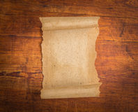 Close up of grunge note paper on wood Royalty Free Stock Photos