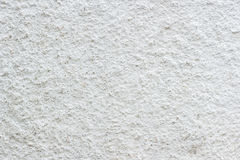 Close up grunge texture white paint cement wall. Royalty Free Stock Photo
