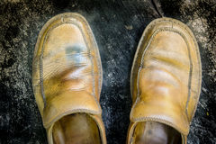 Close-up of grungy leather shoes Stock Photos