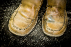 Close-up of grungy leather shoes Stock Images